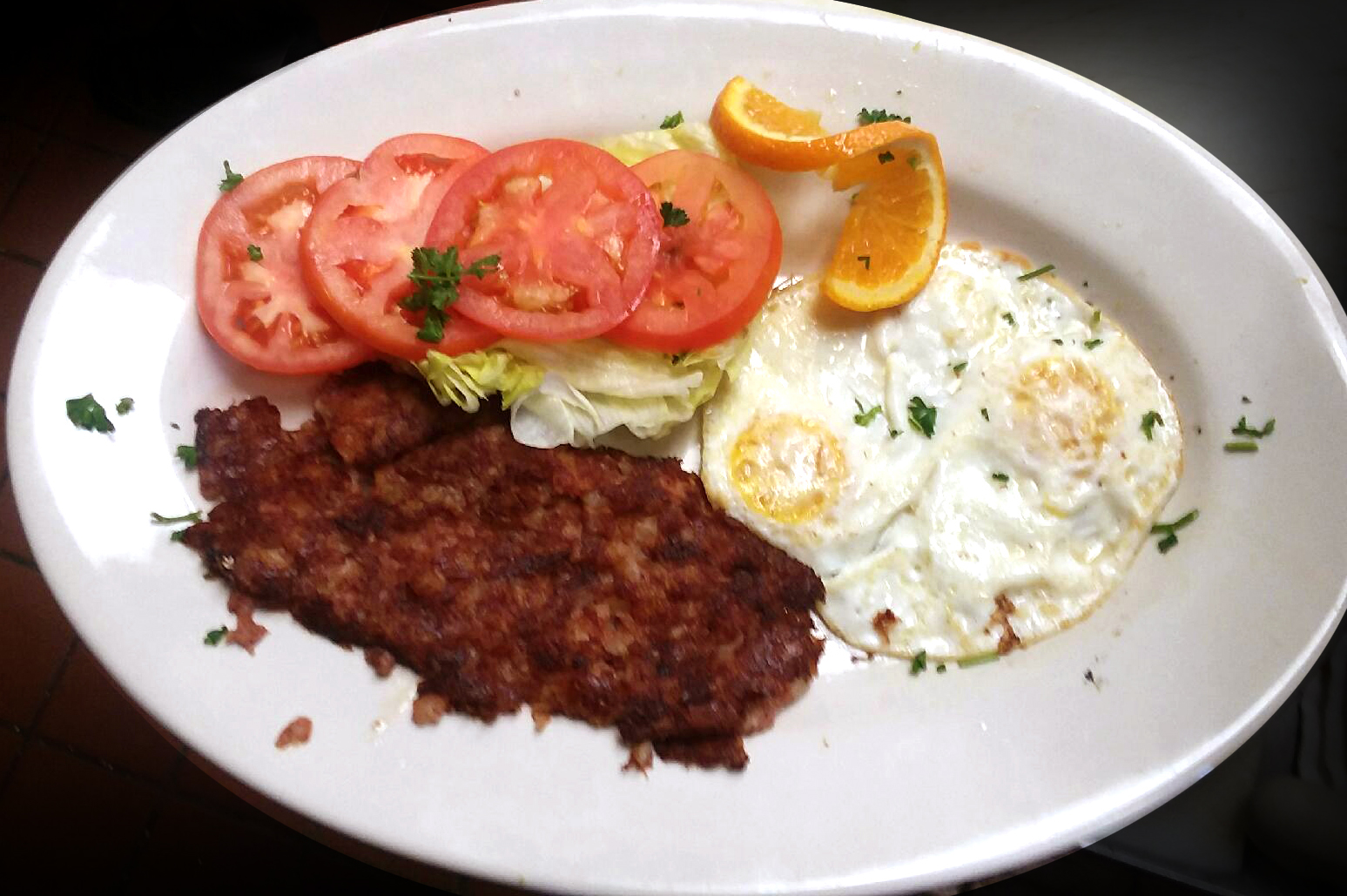 Corn Beef Hash with 2 Eggs and Sliced Tomato